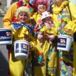 Picture to clowns at Padstow's Easter Egg Rolling Event