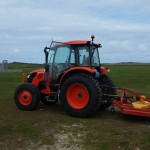 Tractor mowing the Meadows Camping Field at Mother Ivey's Bay