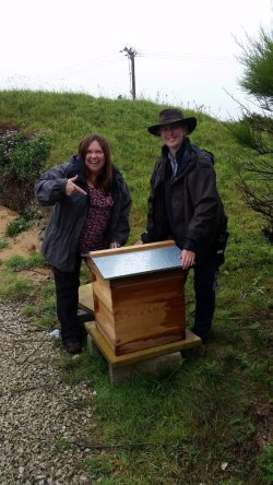 A picture of Mother Ivey's Bay's Gardener Alison with Sarah from David Bellamy Awards and our new beehive