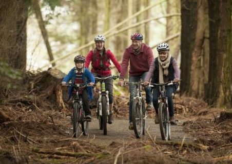 Image of family cycling in lanhydrock
